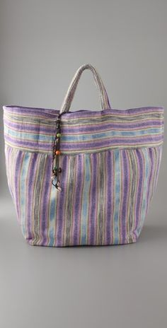 I have this in red/blue combo. JADEtribe Stripe Beach Bag