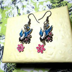 SALE Darling Tattoo Style Silver Blue Winged Sparrow Bird Charm Earrings w/Dangling Chain Resin Flowers & Light Pink Rhinestones FREE SHIPPING - Only $5.95 on Etsy! https://www.etsy.com/listing/234616146/sale-darling-tattoo-style-silver-blue