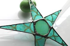 Spotted & Stacked Eggs Star- 9 inch lacquered paper on glass star with stained glass center  kurtknudsen.etsy.com