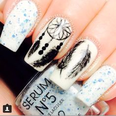 Dream catcher nails. I would have painted the rest black!