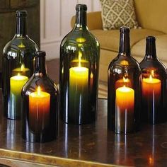 Wine Bottle Hurricane Lamps - Wine Bottle Crafts - 10 New Uses for Old Bottles - Bob Vila Use battery operated tea lights instead of candles. Diy Projects To Try, Craft Projects, Craft Ideas, Decor Ideas, Diy Ideas, Ideas Para, Ideias Diy, Old Bottles, Recycled Bottles