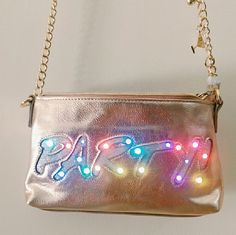 """Betsey Johnson Light Up Bag Adorable rose gold bag that lights up! It's faux leather with a top zip closure. It comes with a good time hardware and flashing lights.  5.5""""H x 9""""W x 1""""D and 22"""" crossbody strap.  Brand new and in perfect condition. No trades. Betsey Johnson Bags Crossbody Bags"""