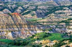 Tiny Medora (population: makes a good base to explore Theodore Roosevelt National Park. Learn about Roosevelt's legacy at activities in town, then head out-by bike, foot, car or horse-to explore the stark beauty of the badlands. North Dakota, Places To Travel, Places To See, Travel Destinations, Rv Travel, Travel Guides, Theodore Roosevelt National Park, Wisconsin, Michigan