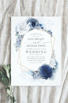 This Dusty Blue and Navy Floral Elegant Wedding Invitation has a beautiful romantic design style featuring a geometric frame in gold glitter over white and blue roses in dusty shades at the background. It is a modern wedding invitation and a part of a suit collection of wedding stationery with the same Dusty Watercolor style that you can edit and personalized.