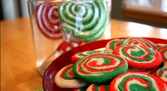 As I was browsing in the grocery store last week, I saw some gorgeous holiday suckers.  The bright red and green swirls caught my eye and I thought, I wonder if we could somehow turn these into cookies¦