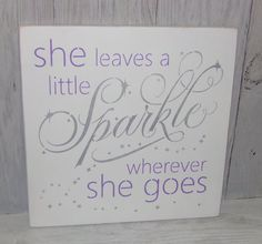 This is a solid wood sign that measures 12 X 12 X 3/4. **It is also available in a 14 X 14 X 3/4    The sign reads:  She Leaves A Little Sparkle Wherever She Goes  The sign shown has been painted WHITE. The lettering has been stenciled with METALLIC SILVER and LILAC. I have sanded the sides and edges for a distressed look.   It has been sealed with 2 coats of satin poly sealer for added durability. We have added a sawtooth hanger on the back for hanging.  If you would like a differe...