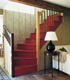 Stepping it up. Red paint makes an otherwise small and unassuming staircase the center of attention.