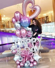 Image may contain: 1 person Balloon Stands, Balloon Display, Balloon Gift, Happy Balloons, Balloons And More, Helium Balloons, 21st Birthday Decorations, Birthday Balloon Decorations, Birthday Balloons