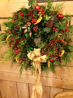 Paula Dackombe's wreath made with holly, ivy, sprucem leylandii, box and variegated ivy all collected from her garden. As well as dried orange slices, cinnamon sticks and holly berries, with Christmas baubles for bling!