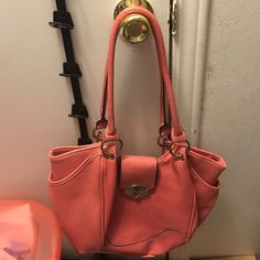 Pink or slight coral color purse Bought at Cato but the purse itself does not say a brand.  Slight minor spot on back of purse hardly noticeable. Cato Bags Shoulder Bags