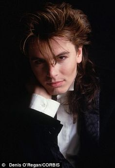 New Romantic: John was inspired by the clothes, hairstyles and make-up of Britain's glam-rock era. This one's for my sis.