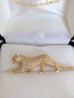 A personal favorite from my Etsy shop https://www.etsy.com/listing/232940915/rare-levian-14k-gold-panther-brooch-pave