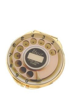 Now this is a blast from the past! Miss the old rotary dial. And of course I'm repinning this from Mom... there's a funny inside story with her & her skills at rotary dialing! ;)   Kate Spade New York telephone dial compact mirror.