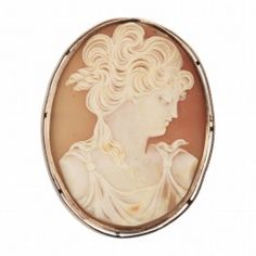 This large authentic Cameo is both a pendant and a brooch, a real head turner!