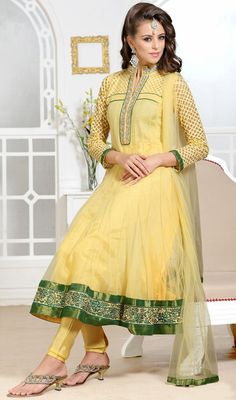 Gleaming Pale Yellow Net Anarkali Suit Real beauty comes out from your dressing style with this gleaming pale yellow net Anarkali suit. The resham and stones work personifies the entire appearance.  #DesignerIndianChudidarSuits #LatestDesignerAnarkaliSuits