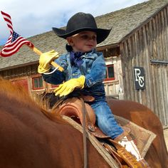 18-month Bronc waves the American flag aloft at our 2015 Memorial Day celebration. We took time before the season's first rodeo to honor the men and women who gave their lives for our country.