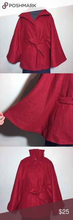 """Jaclyn Smith Red Cape Coat L / XL Jaclyn Smith Red Cape Coat. The material feels like felt. The belt has a worn spot 7"""" from the end. Size L / XL measures flat approximately: 30"""" long, 51"""" at the widest. 2 front snap closures and button at the neck to hold the collar in place, belted waist. 95% poly, 3% viscose, 2% spandex. Fully lined 100% poly. Dry Clean. 121/50/012818 Valentine's Day warm trendy Jaclyn Smith Jackets & Coats Capes"""