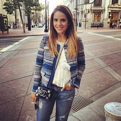 Love the patterned jacket with the distressed denim.  Looks chic and easy.