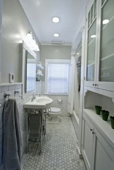 Toilet and sink across from the shower. Toilet leg room is minimal, but there is still an air of space with the open tub/shower instead of having a frameless shower.  Period Carrera Bathroom Remodel - craftsman - Bathroom - Other Metro - True Form Design and Building Inc.