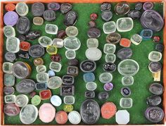 LARGE LOT OF 294 GLASS CAMEO GEMS IN THE MANNER OF JAMES TASSIE