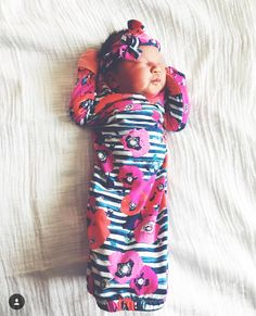 Handcrafted, one-size (newborn to 3 month) layette gowncut from the softest knit in a beautiful, poppyprint withcoral trim. Gown features built-in hand mitts