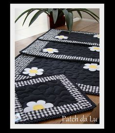 Placemats and mugs rugs. Love the black, white and yellow.....