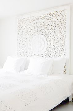 Beautiful white medallion headboard to match the beautiful white bedding
