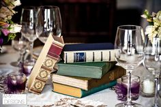 Books accents is a great way to add a little something extra to you wedding tables. @ShanStellmacher #whimsical