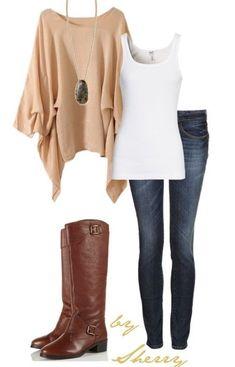 Tan cape, white tank, blue jeans & brown boots