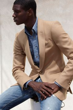 style clash a well fit blazer with denim and denim.