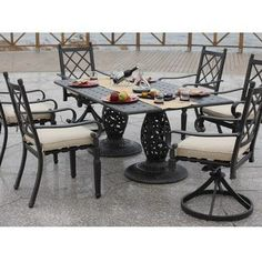 Zamora 7 Piece Patio Dining Set with Swivel Rocker Chair by Bellini Home and Gardens. $2421.00. Belongs to Zamora Collection. Belize Dining Table with Double Grata Base. Commercial-grade aluminum construction. Includes 4 Dining Chairs, 2 Swivel Rocker Chairs and Table. Dessert Bronze (DBZ)/ Dupione Sand Sunbrella (C2005). What is included:Dining Chair (4)Swivel Rocker Chair (2)Table (1) The Zamora Collection, outdoor Dining Set for hosting a large family meal, with ro...