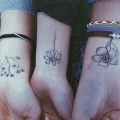 Matching flower tattoos