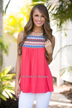 Get your little piece of aztec with this new tank! It's a raspberry top with an aztec style print in red, yellow, green, pink, blue, and sky blue for a standout pattern.