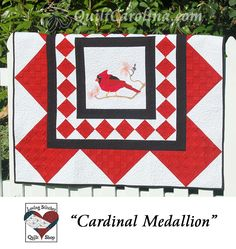 """""""Cardinal Medallion"""" – this beautiful quilt features the state bird and flower, the cardinal and dogwood, appliquéd on a central square with easily pieced borders! A 2017 Quilt! Carolina pattern."""