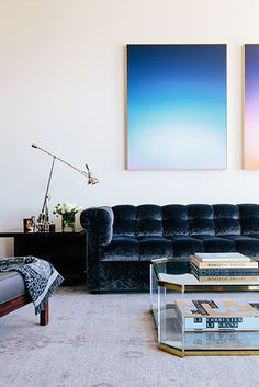 Designer Crush: Catherine Kwong // navy crushed velvet sofa, brass and glass coffee table, Eric Cahan photographs, abstract artwork