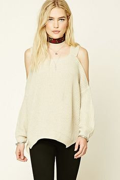 An oversized knit sweater featuring open shoulders, a square neckline, long sleeves, side slits, and ribbed trim.