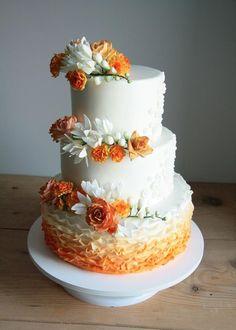 White / orange wedding cake by Agnieszka Czocher