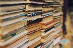 piles of book on the street for sale by  Lia & Fahad| Stocksy United