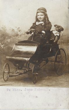 Real Photo Postcard RPPC Girl w/ Old Antique Teddy Bear Doll in Wagon Carriage