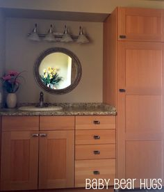 AKRURUM Ikea kitchen cabinets used for a custom bath vanity.. genius!