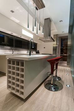 Architecture, Small Modern Kitchen Furniture White Interior Decorating Ideas And Island With Shelves White Laminate Flooring Tile And Red Bar Stools: The Appealing Contemporary Home Wanka House by Galera Estudio