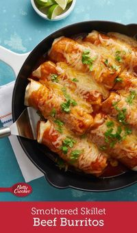 Love burritos and enchiladas? With these hearty burritos, smothered in enchilada sauce, you never have to choose a favorite! They come together in one skillet for a quick dinner that's packed with Mexican flavor.