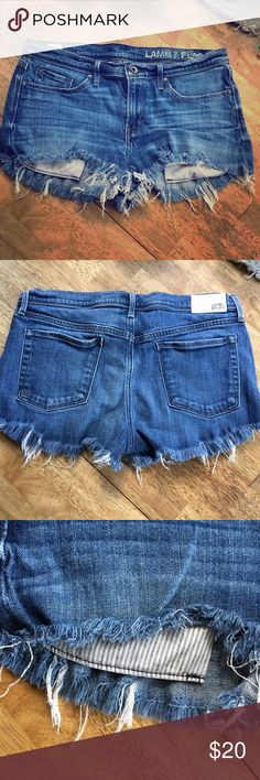 Lamb and Flag Denim Shorts Denim Shorts wth great stretch and cute printed pockets that slightly show. Fits more like 27-28 Shorts Jean Shorts