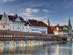 With its covered bridges, turreted buildings, and colorful Old Town, Lucerne is storybook Swiss. Settled on the shores of Lake Lucerne, the city is also a popular departure point for the Swiss Alps, which are visible from the town. Walk the city's famed Kapellbrücke, the oldest covered bridge in Europe, and grab a home-brewed beer nearby at Rathaus Bräuerei when finished. To sample traditional Lucerne dishes like veal with cream sauce and rösti, head to Wirtshaus Galliker, which the…