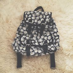 "Daisy Backpack New never used Dimensions: approximately 13"" by 12"" Feel free to ask me any questions Thanks for browsing my closet! Happy Poshing Bags Backpacks"