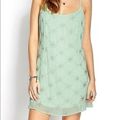 Forever 21 dazzling beaded shift dress Mint green mini shift dress, never worn. Slight brown mark on back of dress can probably be washed out. Forever 21 Dresses Mini