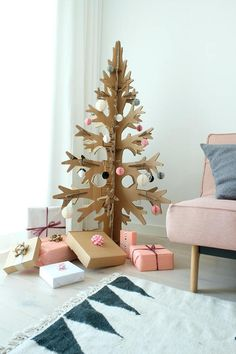 This is alternative christmas tree. It is made of 100% natural recycled cardboard. Its assembled with 6 details and you can store it flat under the bed or whenever without using much space. Put it back together next Christmas and have scandinavian-like modern holiday decoration at