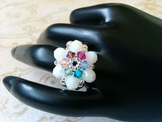 Add a fun, unique piece to your outfit this spring with the Lily White Flower Petal and Rainbow Swarovski Crystal Center Flower Stretch Ring.