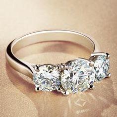 Round Three Stone Julius Klein engagement ring with Forevermark diamonds. Available at Underwood Jewelers #ADiamondIsForever