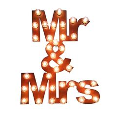 Light up your night with this fantastic, artfully rusted metal marquee sign. Old-fashioned bulbs illuminate your new titles of Mr. and Mrs.. Perfect at your wedding and as ambient lighting at home later!
